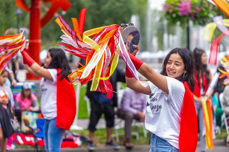 PMG FILE PHOTO - A dancer from Pandero & Danza at the Beaverton Celebration Parade in downtown Beaverton last September. This year, the parade will be held virtually.
