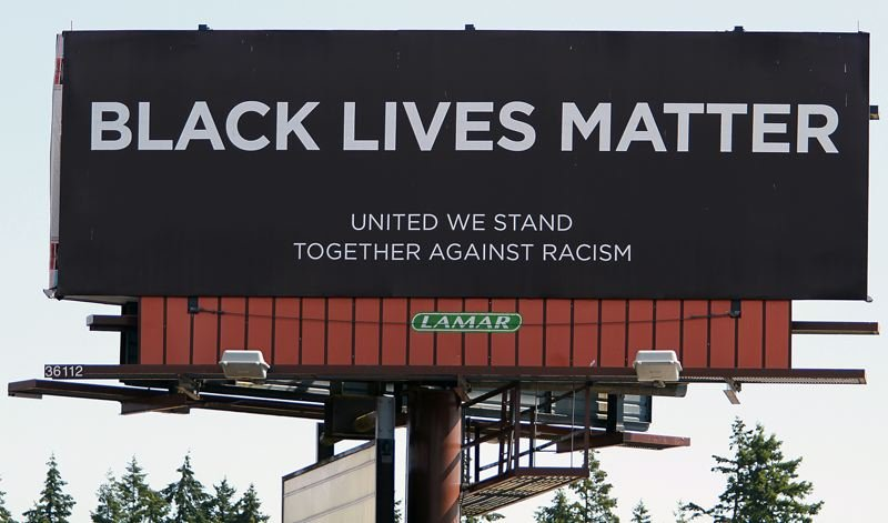 PMG PHOTO: MILES VANCE - The Black Lives Matter billboard on Milton Way is visible from Highway 30 and located adjacent to a competing Back the Blue billboard just a couple hundred yards away.