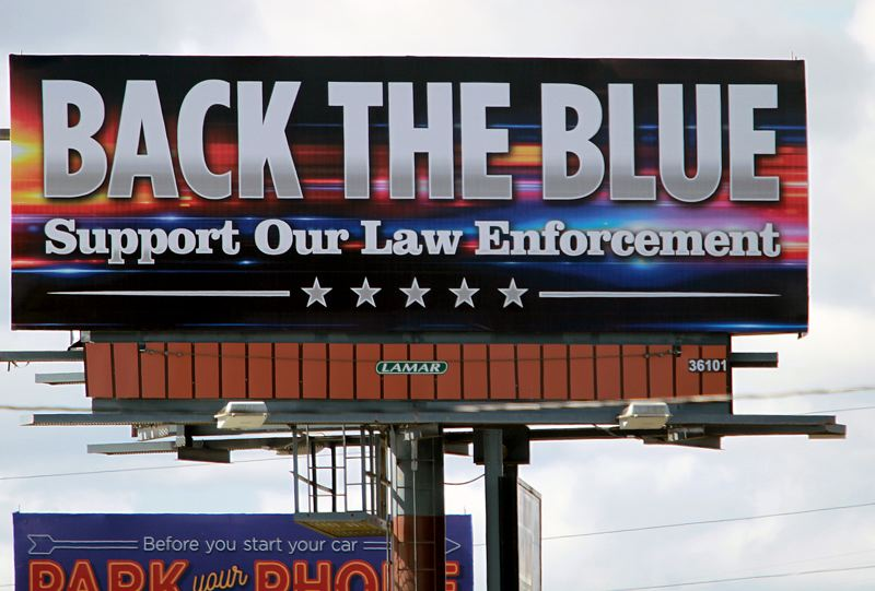 PMG PHOTO: MILES VANCE - The Back the Blue billboard on Milton Way in St. Helens was erected just down the street from the Black Lives Matter billboard that went up in late June.