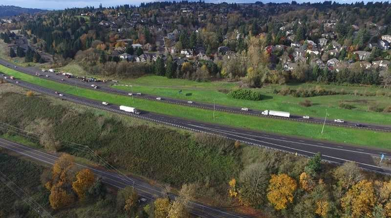 PMG FILE PHOTO - I-205 running through West Linn just west of the Abernethy Bridge and Willamette River.