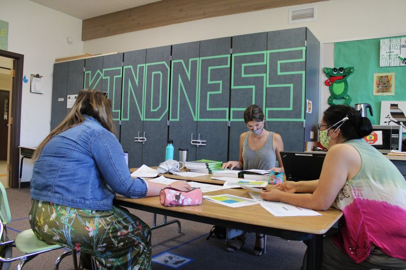 TERESA JACKSON/MADRAS PIONEER - Emily Crowley, a reading teacher at Buff Elementary, Lauren McCartney, a first grade teacher at Buff, and Esther Kalama, a first grade teacher at Warm Springs K-8 Academy, work on curriculum planning Monday, Aug. 3, at Buff Elementary.