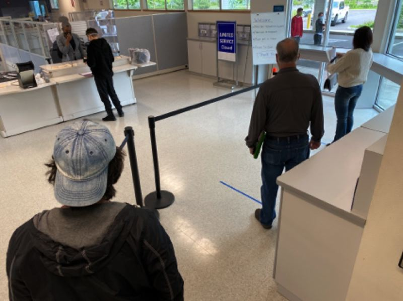 ODOT PHOTO: GREG WESTERGAARD  - Customers keep six feet of distance while awaiting service at an Oregon DMV field office.