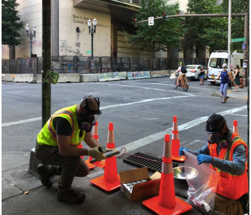 COURTESY PHOTO: PORTLAND BUREAU OF ENVIRONMENTAL SERVICES - Bureau of Environmental Services crews take sediment samples from a stormwater drain across the street from the Mark O. Hatfield Courthouse on Wednesday, Aug. 5 in Portland.
