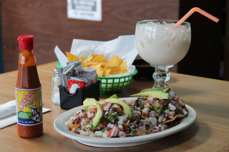 TERESA JACKSON/MADRAS PIONEER - The finished tostada especial and house-made horchata in the newly painted dining room at Antojitos Family Restaurant in Madras.