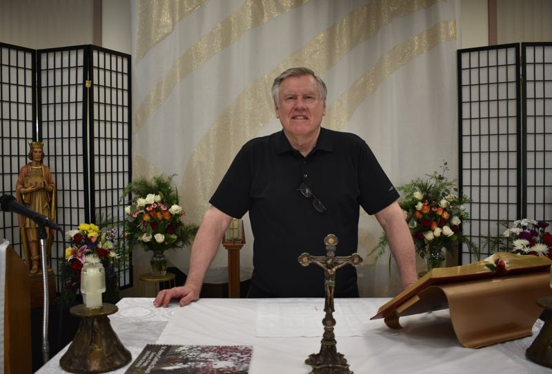PMG PHOTO: TERESA CARSON - The Rev. Charles Zach, pastor at St. Henry Catholic Church, in the makeshift sanctuary set up to make live streaming services easier.