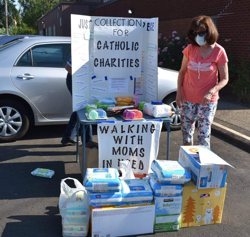 PMG PHOTO: TERESA CARSON - Babies need diapers even in a pandemic and volunteers from St. Henry Catholic Church help struggling families with these necessities.