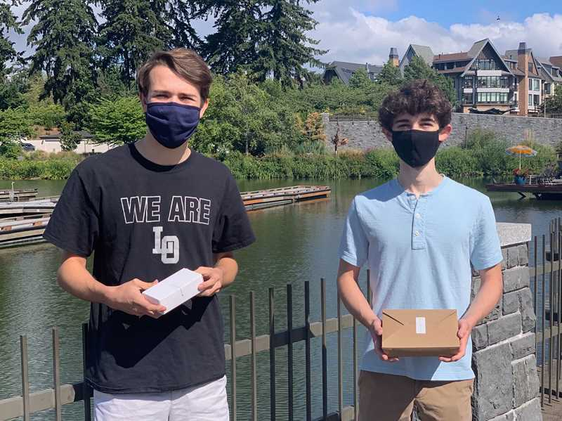 COURTESY PHOTO - Clark Jones, left, and Chris Dettmer are learning about running a business while also helping with coronavirus relief efforts.