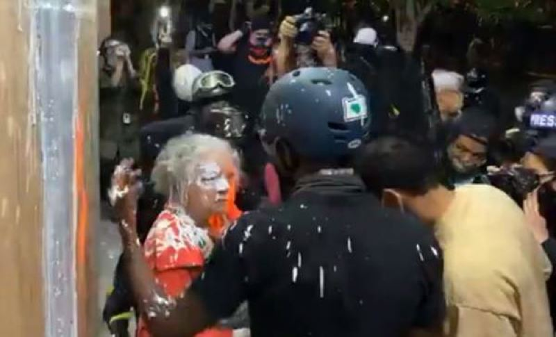 COURTESY PHOTO: PORTLAND POLICE BUREAU - An elderly woman was attacked by protesters and covered with paint outside East Precinct.