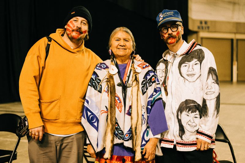 COURTESY PHOTO: JOSUE RIVAS - Portugal. The Man's Zach Carothers (left) and John Gourley visit with Patsy Whitefoot, a member of the Yakama Nation tribe, at a Bernie Sanders rally in Tacoma, Washington, earlier this year.
