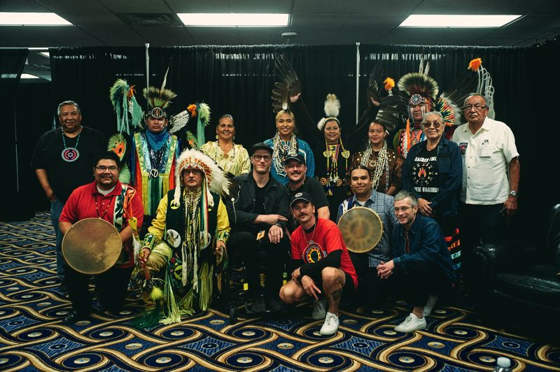COURTESY PHOTO: MACLAY HERIOT - Portugal. The Man band members, whose foundation works to elevate Indigenous voices, poses for a photo with Winnebago and Omaha tribe community members at an event in Council Bluffs, Iowa.