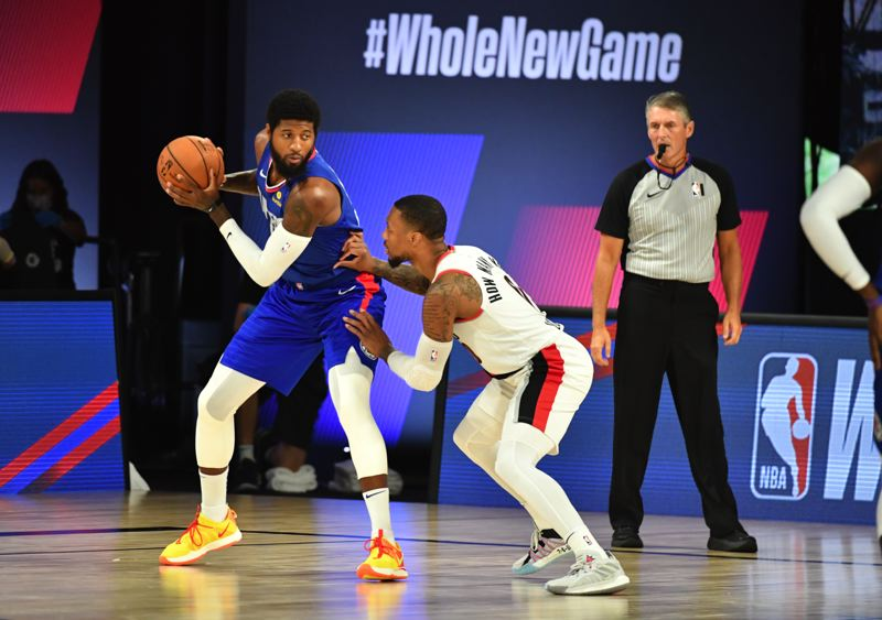 COPYRIGHT 2020 NBAE (PHOTO BY JESSE D. GARRABRANT/NBAE VIA GETTY IMAGES) - Even with the Los Angeles Clippers resting Kawhi Leonard, Damian Lillard and his teammates had a lot to handle, defending Paul George and others.