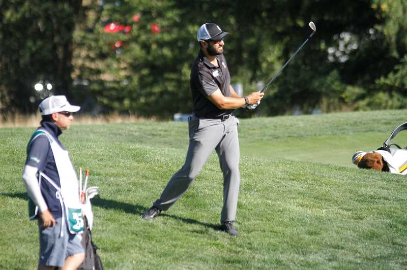 PMG PHOTO: WADE EVANSON - Paul Barjon plays a shot from behind the 17th green during the third round of the Winco Foods Portland Open Saturday, Aug. 8, at Pumpkin Ridge Golf Club in North Plains.