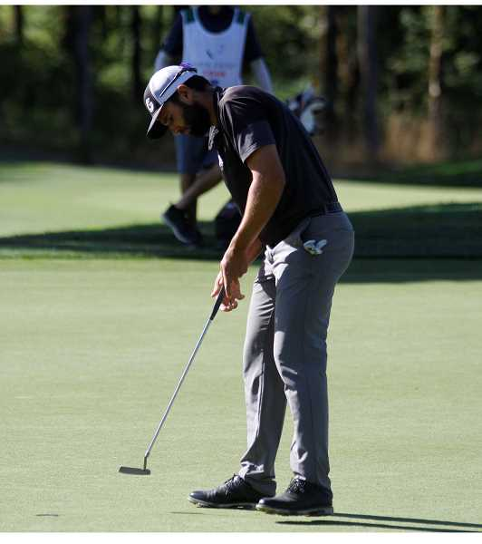 PMG PHOTO: WADE EVANSON - Paul Barjon taps in his putt on the 18th green during the third round of the Winco Foods Portland Open Saturday, Aug. 8, at Pumpkin Ridge Golf Club in North Plains.