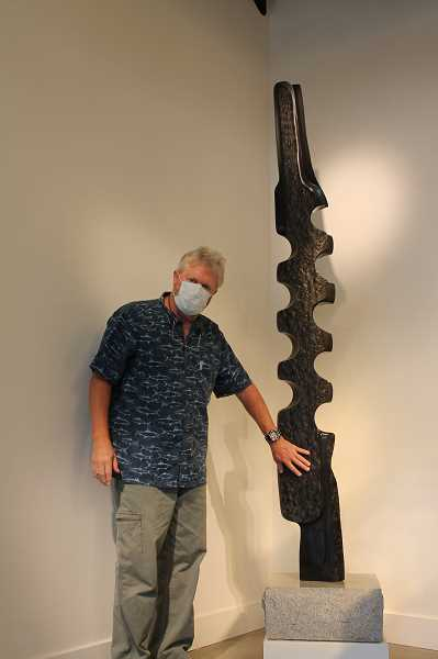 PMG PHOTO: HOLLY BARTHOLOMEW - Dave Haslett of West Linn calls attention to the texture in one of his scultpures from his Vertebrae series.