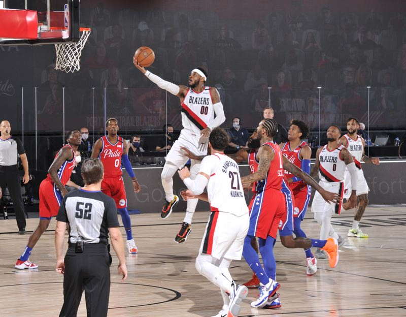 COPYRIGHT 2020 NBAE (PHOTO BY JESSE D. GARRABRANT/NBAE VIA GETTY IMAGES) - Carmelo Anthony moved up two spots on the NBA all-time scoring list against Philadelphia. Damian Lillard scored 51 points in the 124-121 win.