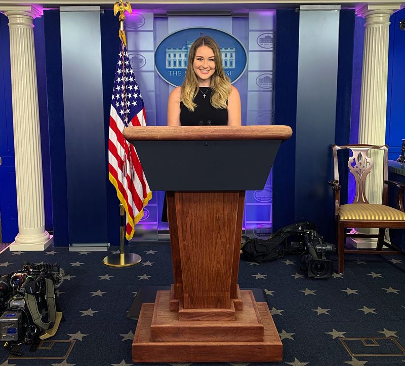 COURTESY PHOTO: EMMA RAE PHILLIPS - Scappoose High School graduate Emma Rae Phillips takes a turn at the lectern in the White House press briefing room during her two-month internship in Washington, D.C.