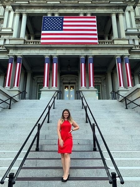 COURTESY PHOTO: EMMA RAE PHILLIPS - Scappoose's Emma Rae Phillips pauses on the steps to the Eisenhower Executive Office Building adjacent to the West Wing of the White House in Washington, D.C.