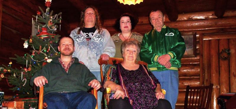 COURTESY PHOTO: BRAD AND JEWEL STOCKLI - The Stocklis, pictured bottom left and top middle, spend ample family time at Laughing Bear Cabin. This past family photo includes Brads parents and brother.