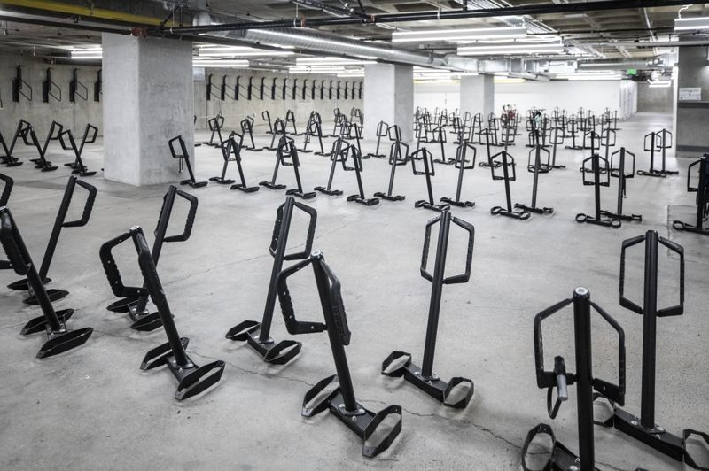 PMG PHOTO: JONATHAN HOUSE - Rows of bike racks sit unused in basement of the Portland Building.