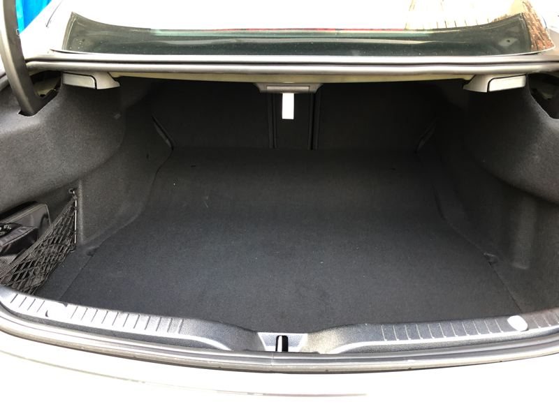 PMG PHOTO: JEFF ZIRSCHMEIDE - In addition to offering dramatic performance, the C63 S also offers reasonable utility. The trunk is big enough for generous luggage for two people.
