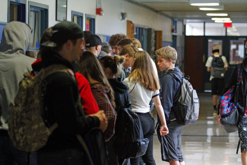 PMG PHOTO: WADE EVANSON - Students pack the hallways on the first day of classes last year at Banks High School, on Sept. 4, 2019.