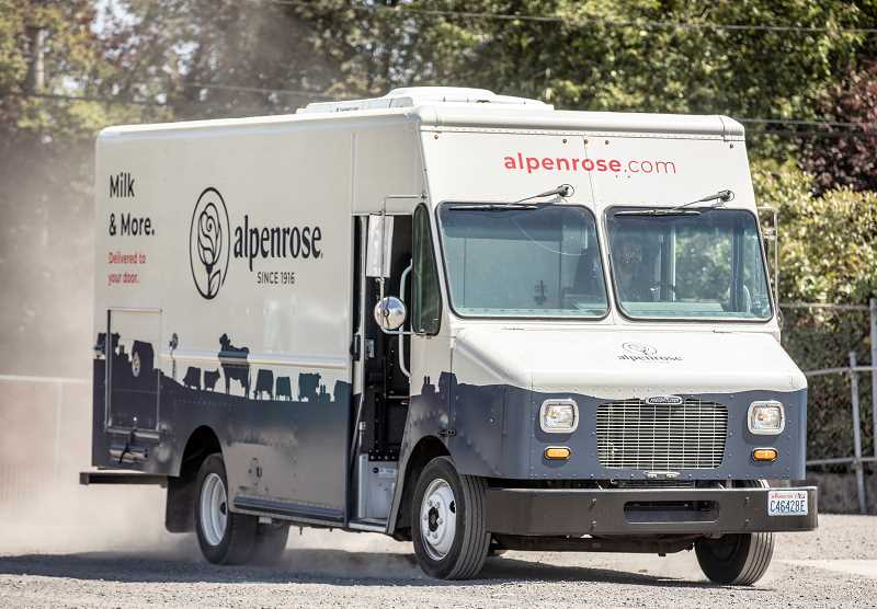 PMG PHOTO: JONATHAN HOUSE - A delivery truck pulls around the Alpenrose parking lot at the end of the day.