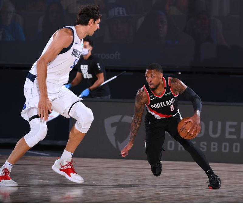 COPYRIGHT 2020 NBAE (PHOTO BY GARRETT ELLWOOD/NBAE VIA GETTY IMAGES) - Damian Lillard scored 61 points, and made key plays passing and defending, as the Trail Blazers beat Dallas on Tuesday.