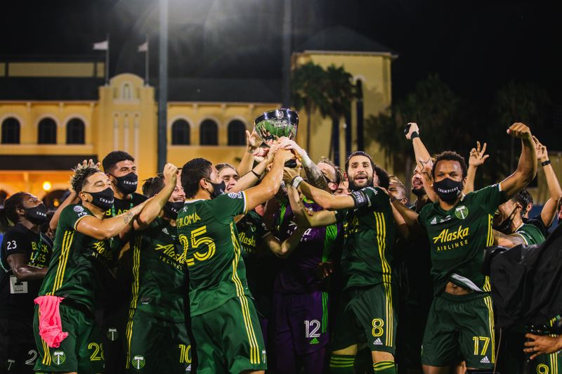 COURTESY PHOTO: MATTHEW STITH/MLS/ADIDAS CREATORS NETWORK - The Portland Timbers raise the trophy at the MLS is Back tournament in Orlando on Tuesday after a 2-1 win over Orlando City in the tournament's championship match. Portland went unbeaten (six wins, one draw) in the tournament.