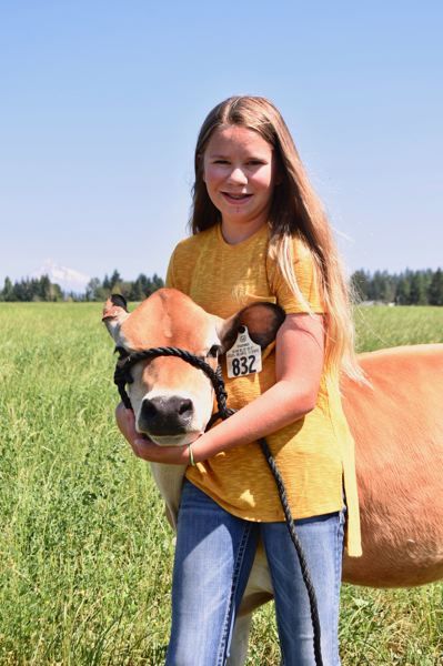 PMG PHOTO: BRITTANY ALLEN - Autumn juggles caring for her cow and the others at Cloud Cap with maintaining her 4.0 GPA, playing in band and playing soccer.