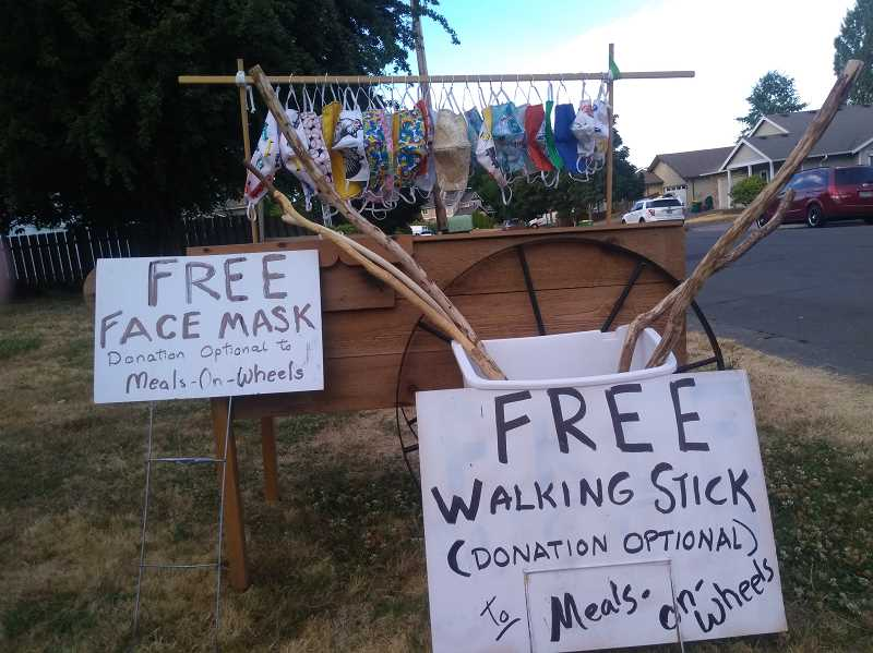 COURTESY PHOTO - A rack full of free masks sits on Norma and Larry Hill's lawn. The couple made and gave away free masks and walking sticks in return for donations to Meals On Wheels.