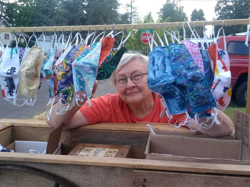 COURTESY PHOTO - Forest Grove's Norma Hill with a series of her masks that she made and offered for free in return for donations to Meals On Wheels.