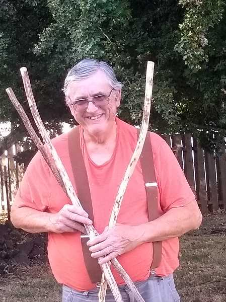 COURTESY PHOTO - Forest Grove's Larry Hill with a couple of his walking sticks that he gave away in return for donations to Meals On Wheels.