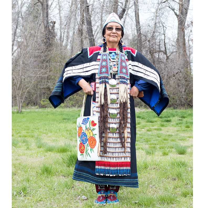 COURTESY PHOTO - Roberta Kirk displays an outfit she made. She has received numerous awards for her museum-quality work. She has also worked at The Museum at Warm Springs and is a consultant for the High Desert Museum.