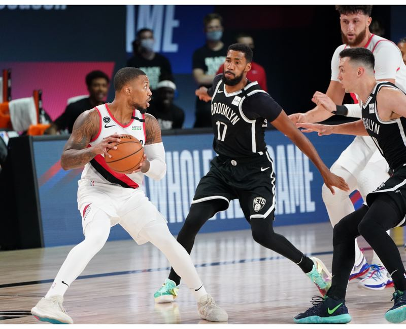 COPYRIGHT 2020 NBAE (PHOTO BY JESSE D. GARRABRANT/NBAE VIA GETTY IMAGES) - The Brooklyn Nets played decent defense against Damian Lillard, but he still scored 42 points in leading the Blazers to a 134-133 win Thursday.