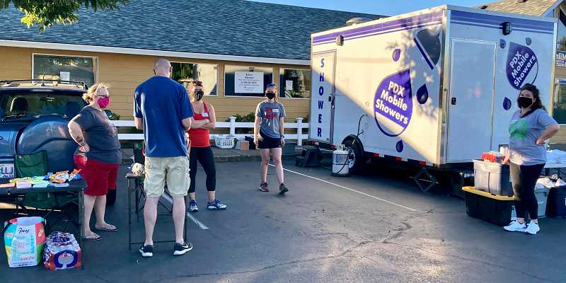 COURTESY PHOTO - LoveOne, a Clackamas County nonprofit, launched a mobile shower cart effort in Oregon City on Aug. 9. The next event will be at Milner Veterinary Hospital from 6-8 p.m. Sunday, Aug. 23.