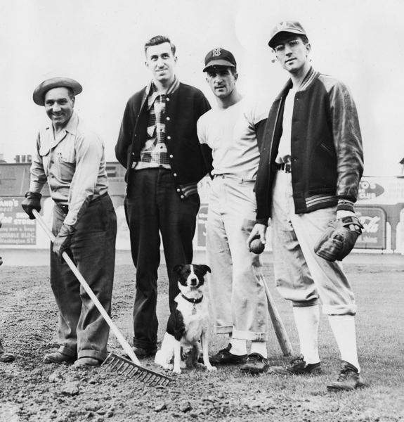 COURTESY PHOTO: DON NELSON/VINCE PESKY - Vince Pesky (right) poses for a photo with brothers Johnny (second from right) and Tony (second from left) and Vaughn Street Ballpark groundskeeper Rocky Benevento (left).