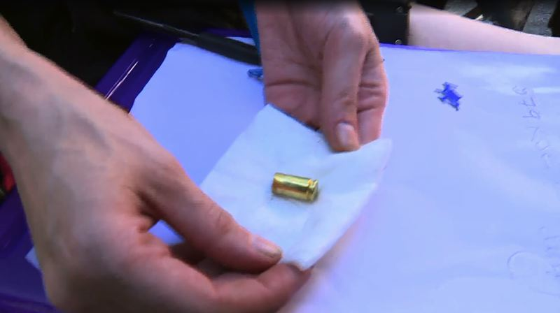 SCREENSHOT  - A protester displays a shell casing used during a protest in dowtown Portland on Aug. 15.