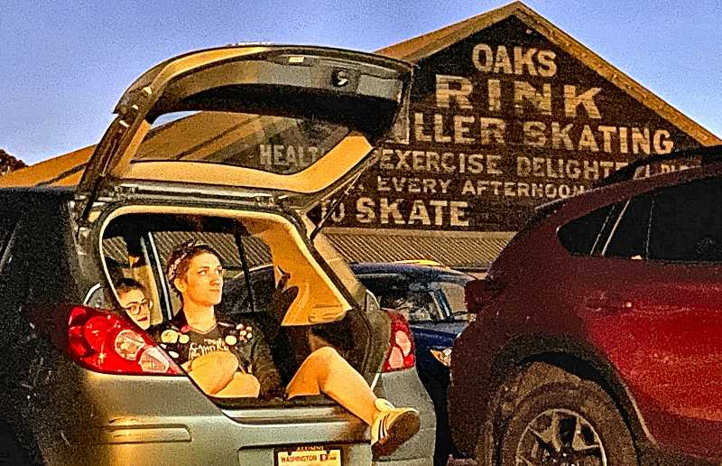 PAIGE WALLACE - Moviegoers get comfortable inside their vehicles at Cinema Under the Stars, a drive-in movie fundraiser from Portlands Rose City Rollers roller derby team, at Oaks Park - in response to the current inability to offer roller derby during the COVID-19 pandemic.