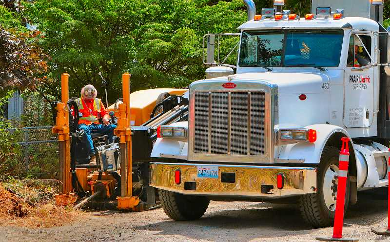 DAVID F. ASHTON - PBOT workers are involved in the process of installing underground utility improvements near Flavel Park, as part of the Springwater Connector Neighborhood Greenway project.