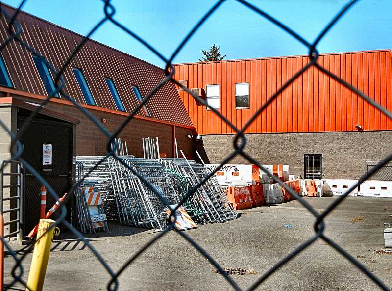 ELIZABETH USSHER GROFF - Sidewalk and road barriers and other materials, in preparation for demolition of the Joinery building on Woodstock Boulevard, have been stored on the block for months. Now another extension for demolition and construction has been requested and granted.