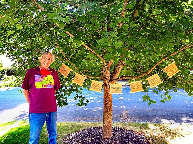 ELIZABETH USSHER GROFF - Douglas Yarrow has been hanging creative home-crafted items from his sidewalk maple tree - he calls it the Poetree - in the Reed Neighborhood for a decade. This month, the Black Lives Matter movement inspired him to place a poem on it by Langston Hughes.