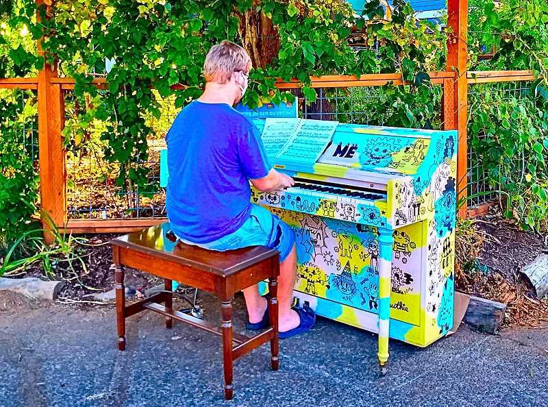 BECKY LUENING - This pianist brought his own sheet music to play Chopin, to the delight of nearby neighbors. The lush garden and the way the fence and sidewalk come together at this particular corner - S.E. 60th at Steele - turned out to be a great location for the piano, which was supplied by a Portland nonprofit called Piano. Push. Play.