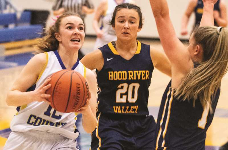 CENTRAL OREGONIAN - Dallas Hutchins goes to the basket for the Cowgirls during the 2019-20 season. Bob Boback, who had good success coaching girls basketball in Washington, is coming out of retirement and moving to Prineville to take the job as head coach.