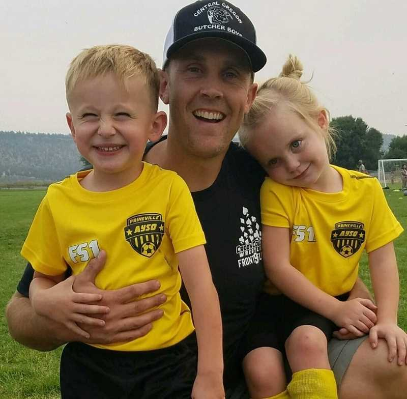 COURTESY PHOTO - Johnny Oelkers, center, is the new Crook County varsity boys soccer coach. He's shown here with youth soccer players Titus Rodgers, left, and his daughter Callie Oelkers.
