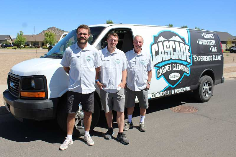 JASON CHANEY - Bryan Housley (middle) is taking over his father's Cascade Carpet Cleaning business. Steve Housley (right) started the business in Prineville in February 1977. Bailey Thomason (left) represents the third generation of carpet cleaners.