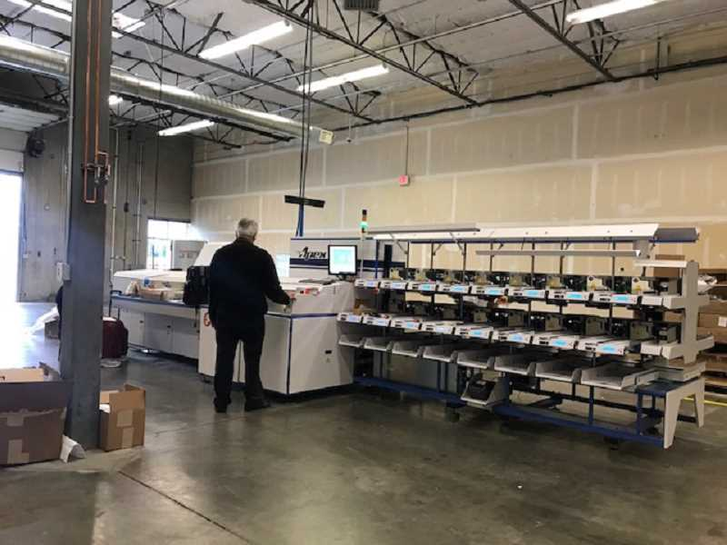 UPLOADED BY: EGENER, MAX - One of two automated mail sorters, the size and weight of a midsized car, which have helped process envelopes sent to the Washington County Elections Office during elections in recent years.
