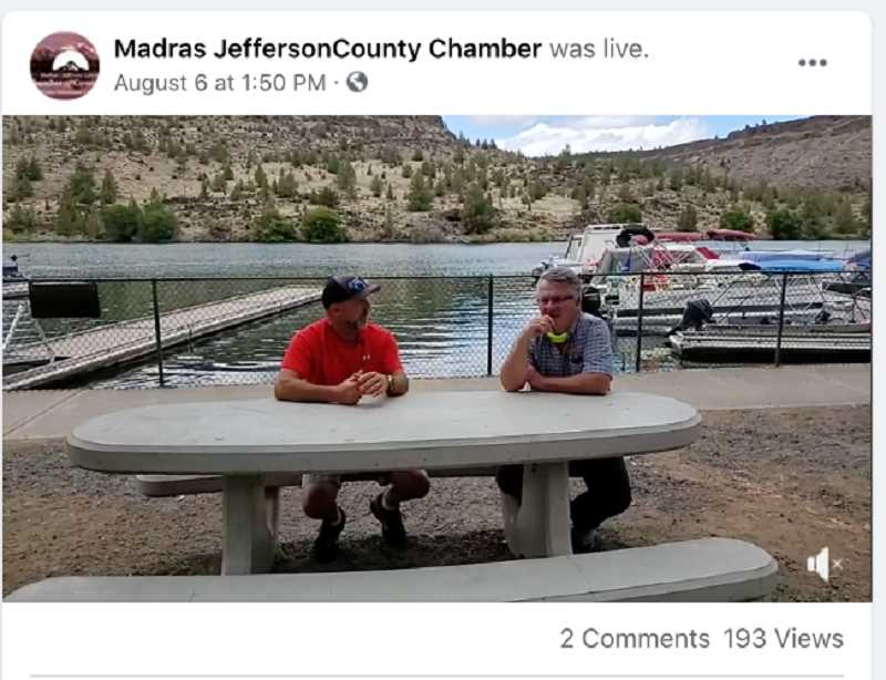 COURTESY PHOTO - The Madras-Jefferson County Chamber of Commerce takes its new Chamber Cheer to Fraser's Deep Canyon Grill. Executive Director Joe Krenowicz, right, talks with owner Lee Fraser.