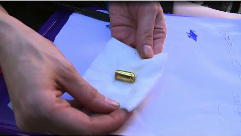 FILE - Protesters recovered a shell casing during a protest on Aug. 15.