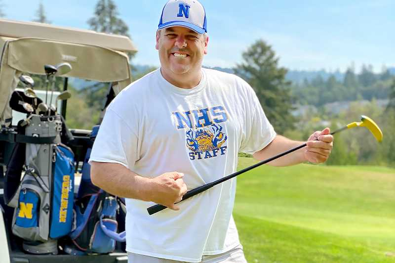 COURTESY PHOTO: NHS BOOSTER CLUB - Newberg High School vice principal and dozens of others participated in the Newberg Booster Club's annual golf tournament at Chehalem Glenn Golf Course.