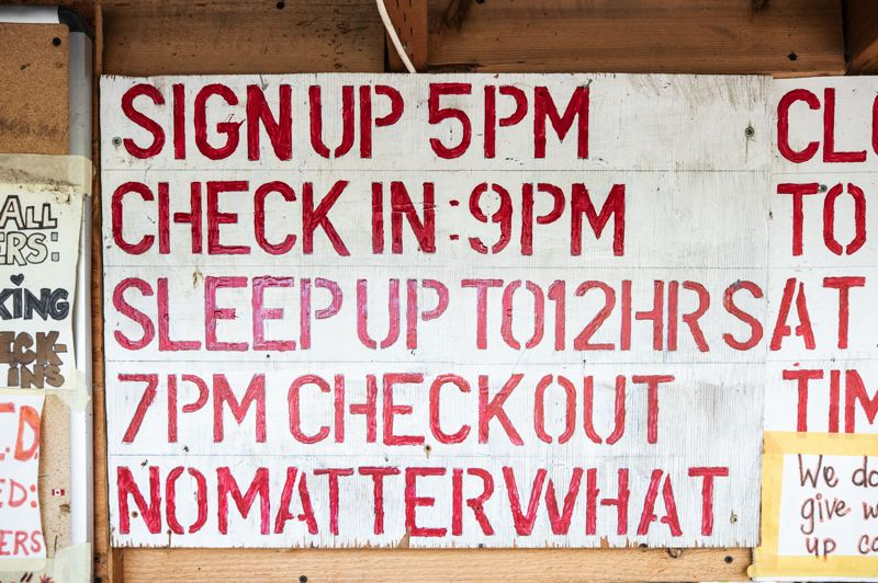 PMG PHOTO: JONATHAN HOUSE - A sign explains the rules for overnight sleepers at Right 2 Dream Too. The camp has both day-shift and night-shift sleeping hours.